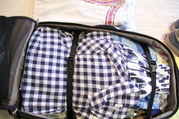 use the suitcase straps to minimize wrinkling and lay toiletries bag and dress bag over them