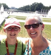 At the World War II Memorial with the Lincoln Memorial in the background.